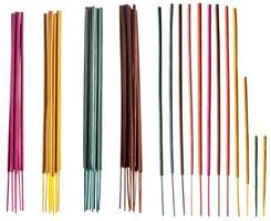 Colorful groups and individual incense sticks isolated on white background. photo