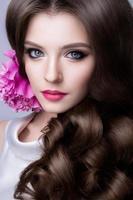 Close-up studio portrait of beautiful woman with bright make photo