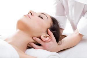 Woman enjoying massage at beauty spa photo