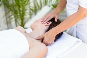 Brunette receiving neck massage
