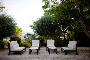 Cream spa chairs in French country setting photo