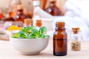 Natural Spa Ingredients essential oil with oregano leaves for ar