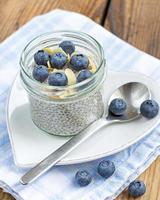 vanilla chia seed pudding with blueberries and almonds photo
