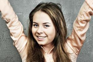 young Caucasian girl raised her hands