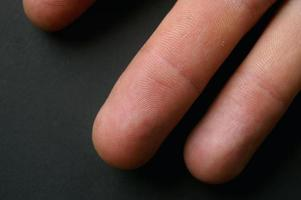 Close up of fingers showing finger prints photo
