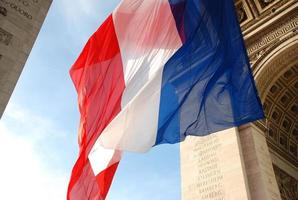 Large French flag blowing in the wind