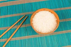 Rice and chopsticks photo