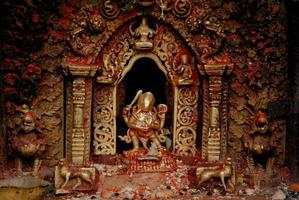 Bronze Goddess at Hindu temple in Nepal . photo