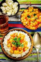 rice with curry chickpeas with vegetables and Arabic flat bread with herbs