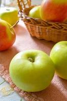 Green and red organic apples in basket photo