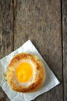 Round bread bun with egg inside bun