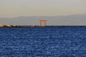 Japanese Torii Gate in the Water photo