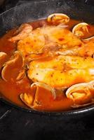 Cooking hake in sauce