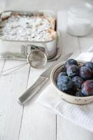 Preparing plums for cake photo