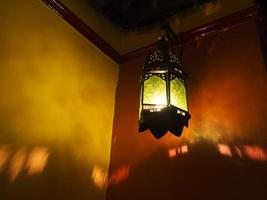 Exotic Middle Eastern,Moroccan style lantern casting shadows photo