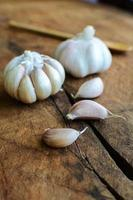Close up of garlic on old wooden table photo