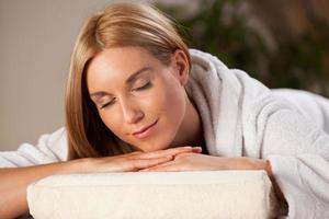 Woman in dressing gown in spa photo