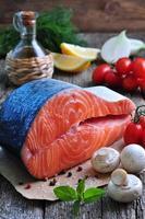 raw salmon steak with cherry tomato, mushroom, onions, dill, garlic