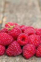 raspberries on wooden surface photo