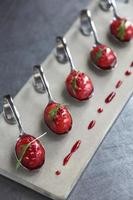 Strawberry soup spoons photo