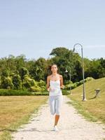 Young woman jogging in park photo