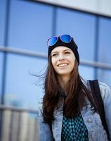cute brunette teenage girl in hat, student outside