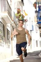 Fit young man running exercise in town