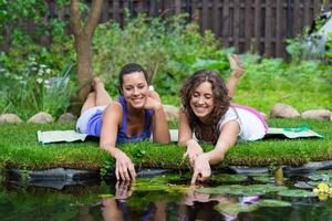 Two beautiful young brunet woman outdoors photo