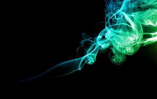 Green and blue smoke on dark