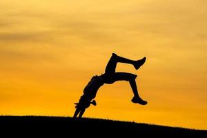 Doing a back bend at sunset.