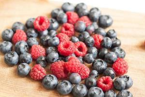 Heart of juicy ripe berries blueberries and raspberries