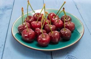 cherries on a blue board photo