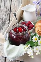 Homemade delicious raspberry jam photo