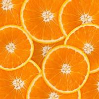 Abstract background with citrus-fruit of orange slices. photo