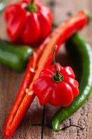Red and green chili peppers photo