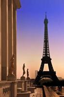 Eiffel Tower and silhouettes of sculptures. View from the Trocadero