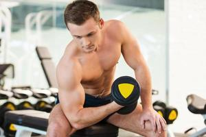 Exercising with dumbbell. photo
