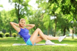 Girl in sportswear exercising outdoors