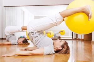 women making fitness exercises with ball