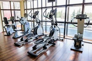 Gym interior with many treadmill machines