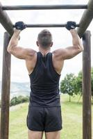 Athletic man exercising and training, outdoor. photo