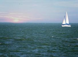 Sail boat out at sea photo