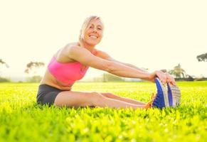 Young woman stretching before exercise photo