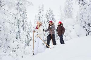 Young adults snowshoeing