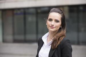 Caucasian business woman standing outdoors. photo