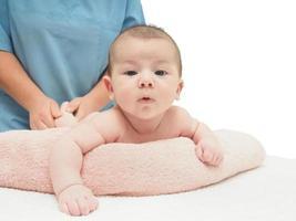 Doctor massage small caucasian baby photo