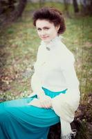Romantic caucasian woman in vintage outfit. Retro style photo