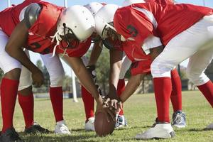 Football Players in Huddle photo
