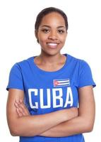 Standing woman from Cuba with crossed arms photo
