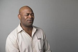 African American man singing with his eyes closed